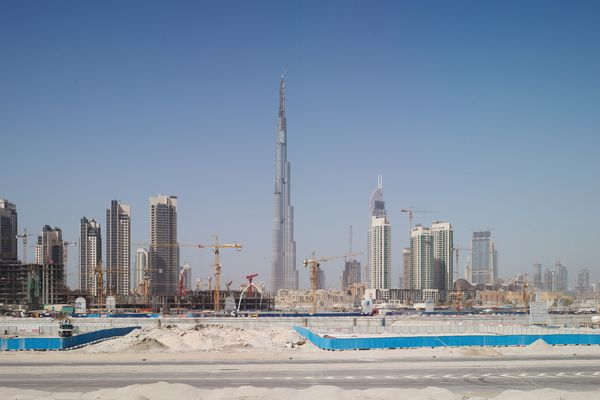 "Highrise construction in Dubai, UAE, where much of the architecture is designed from afar, with little connection to the nuances of place. Juhani Pallasmaa describes it as ""almost irresponsible to design buildings in alien cultures."""