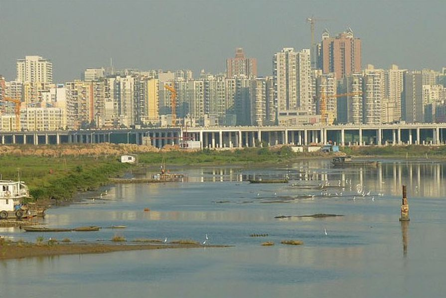 The site is mainly reclaimed land; the area has exceptionally poor water quality.