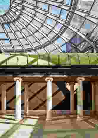 A colonnade, part of the existing roof structure, has been incorporated into the rooftop addition.