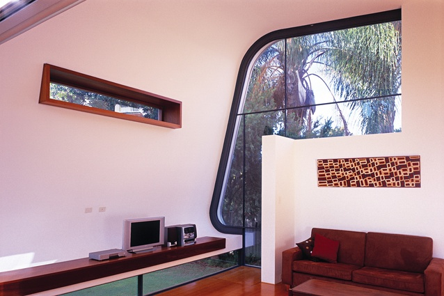 The curving form of the roof is expressed internally and frames a view to the garden.
