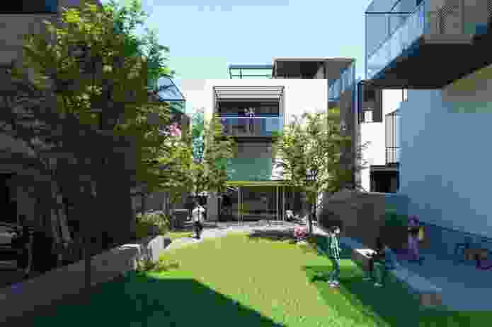 """The dwellings are based on interchangeable """"modules,"""" comprising apartments that are vertically stacked to three or four storeys, and clustered in sets around a central courtyard."""