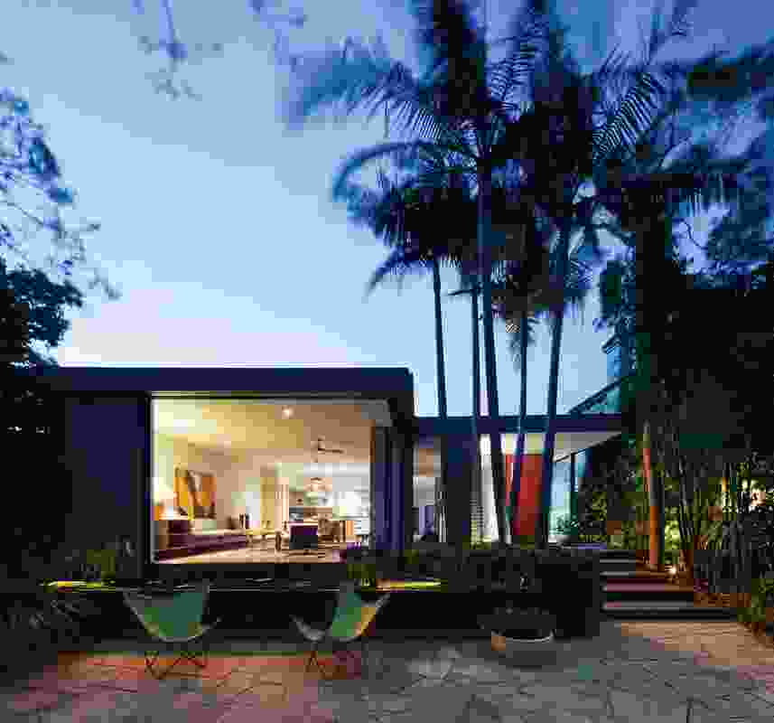 The design strikes an intentional visual balance between garden and residence.