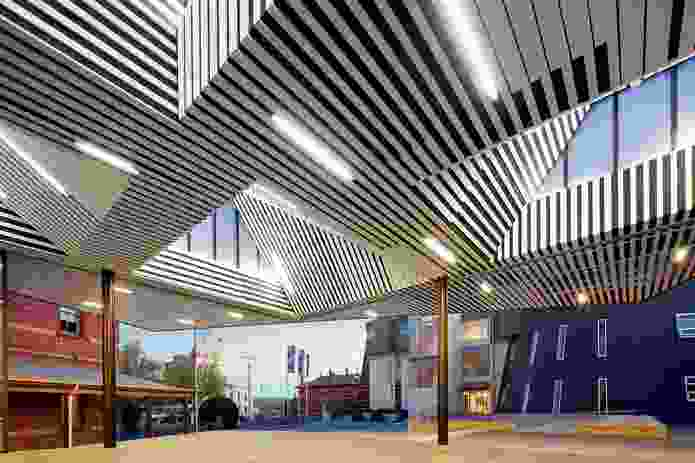 White battens are fixed to black acoustic fabric to create a striated effect.