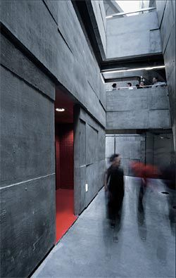The atrium at ground level, with a red ancillary space to the left.
