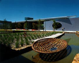 "Shallow pools and an ""art wall"" at the entrance to the Peel Education and TAFE campus. Image: Patrick Bingham-Hall"