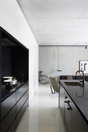 Monochromatic hues mark different components of the apartments; glossy black and soft white are set against shades of grey.