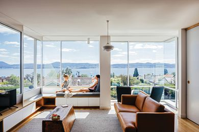 An engaged column caps off an integrated window seat and delineates two cosy sitting spaces looking over Sandy Bay.