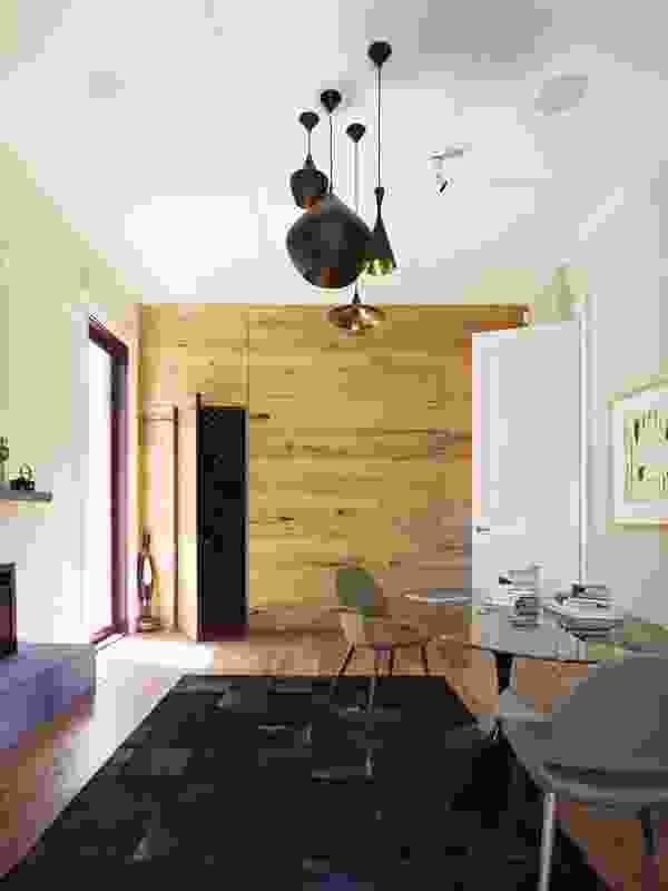 The study features a storage wall clad in wide blackbutt timber boards.