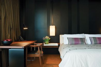 Hotel bedrooms are moody and contemporary with individually selected touches.