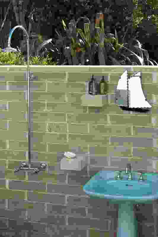 An outdoor shower provides an opportunity to further connect with the home's natural setting.