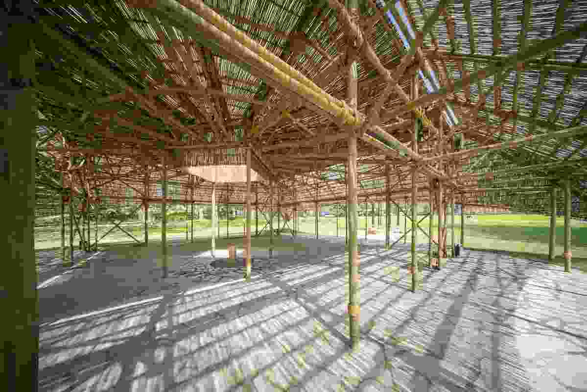 The 2016 MPavilion by Studio Mumbai features a symbolic, gold-leaf-covered bore.