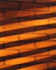 Shadows on the locally made stabilised earth brick.Image: Brett Boardman