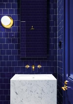 A vivid Victorian blue powder room is one of a series of small interventions in the existing house.