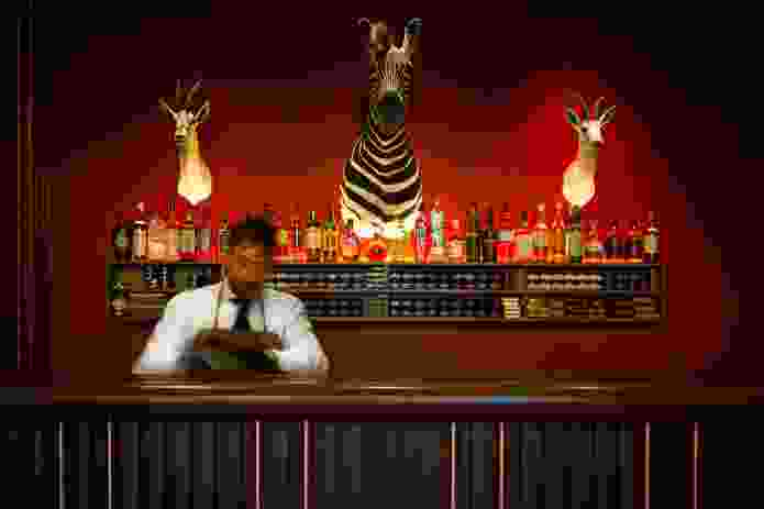 Guests are invited to make themselves comfortable at the well-stocked bar.