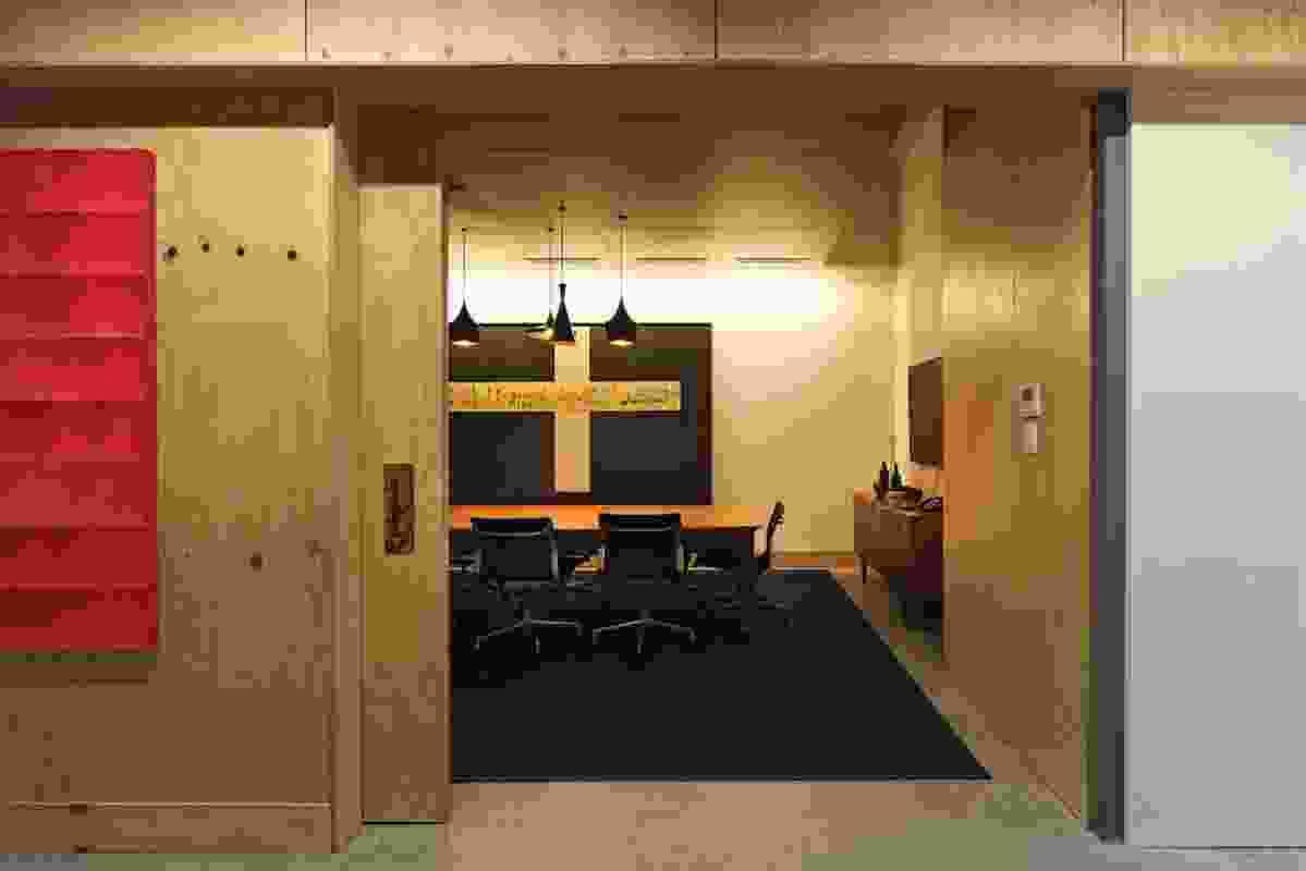 Meeting room with Tom Dixon Beat Lights. Artwork: Sandra Kadji-O'Grady.