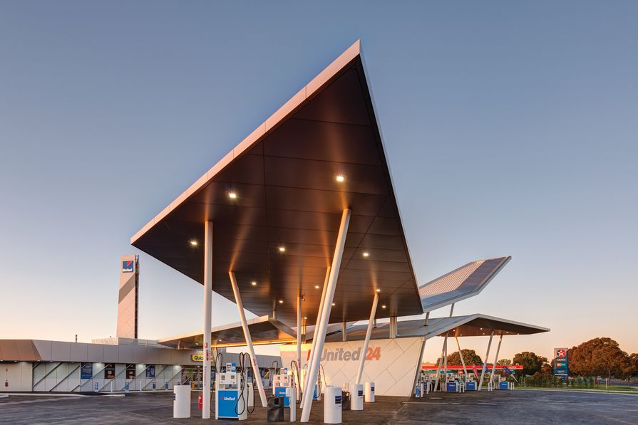 Sandwiched between an older-style petrol station and a furniture store, the building is a sculptural marvel in an otherwise featureless road.
