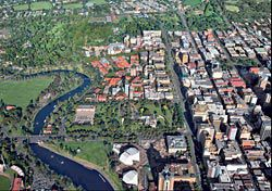 Aerial view showing North Terrace as a mediating element between the escarpment and CBD grid and the Torrens River below. Image: John Gollings