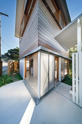 Sliding doors allow the tower to engage with the backyard.
