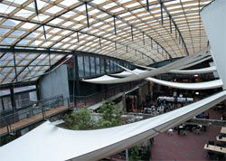 Overview of the atrium, with sails beneath the striking curved roof.