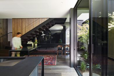 The kitchen and dining area borrow light and fresh air from the adjacent courtyard.