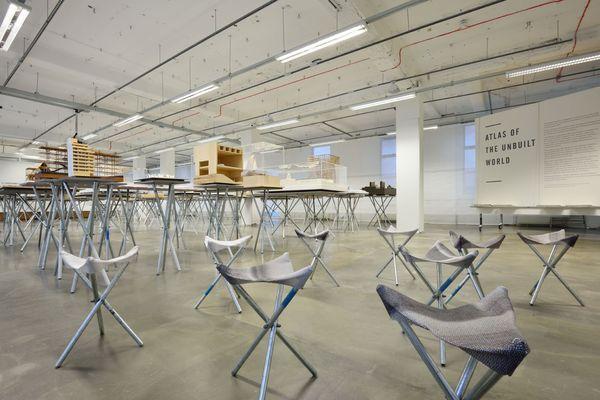 Atlas of the Unbuilt World exhibition: 65 models arranged in a geometric landscape.