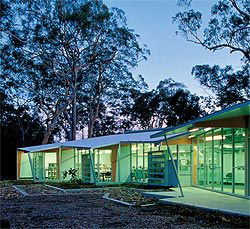 Looking along the northern edge of the Noosa Arts and Environmental Tourism Centre. With little separation between interior and exterior, the teaching spaces are reminiscent of an enclosed verandah.Image: Richard Stringer