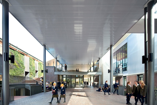 An external thoroughfare with central cafe form a new social hub for the school.