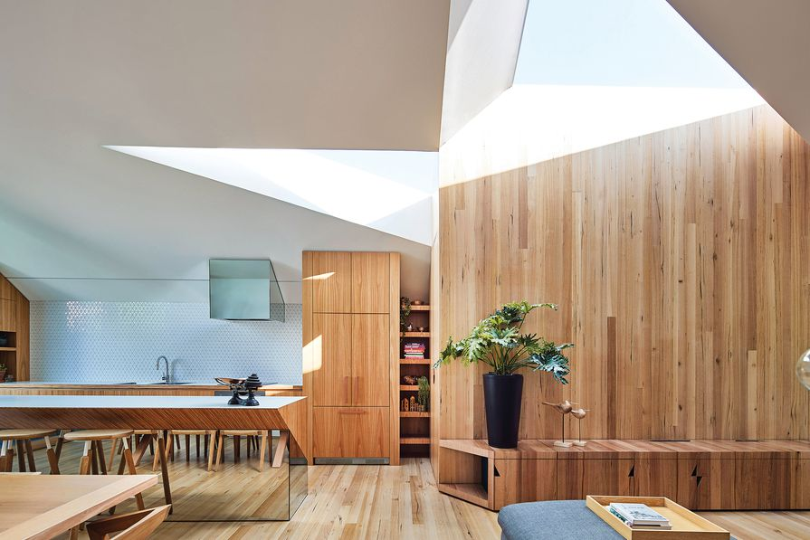 Twin skylights meet to form an abstract infinity symbol, which represents the owners' relationship.