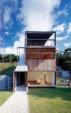 Front elevation. Although set back against a hill, every level of the house engages with the street in some way. Image: Brett Boardman