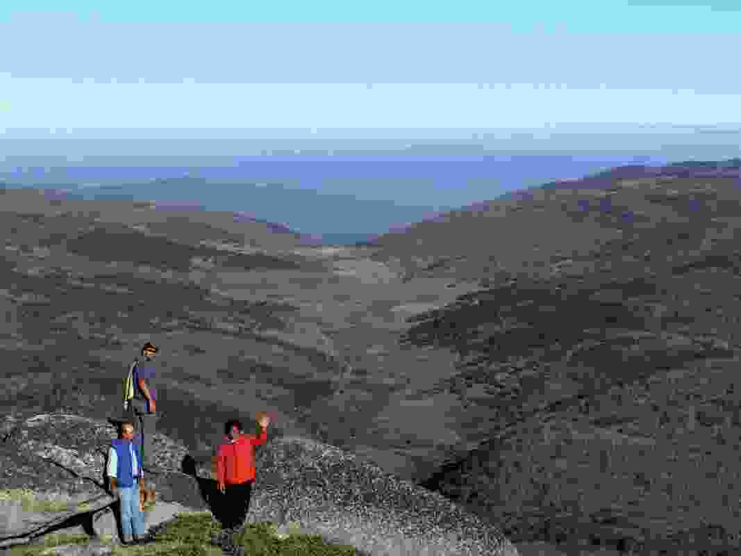 A group surveying the Bundian Way overlook its route east toward the Monaro and Tingiringi, on the New South Wales-Victoria border.