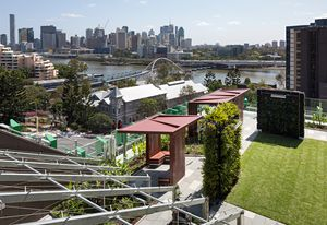"""Grassed areas in the Lady Cilento Children's Hospital """"secret garden,"""" with views to the Brisbane River and CBD."""