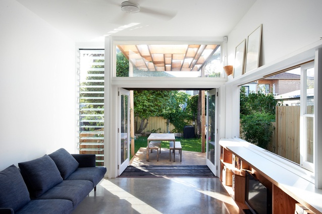 The sunken rear living space connects nicely to the garden.