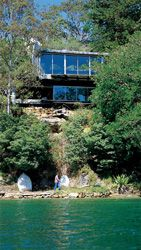 The water edge facade. The house snuggles into the bush on the northern tip of Sugarloaf Point, Castlecrag.
