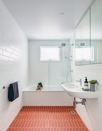 Terracotta tiles in the bathroom weave a hint of the old building fabric into the new.