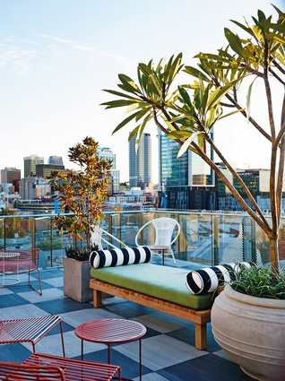 A private roof terrace affords commanding urban views across Perth CBD and Northbridge.