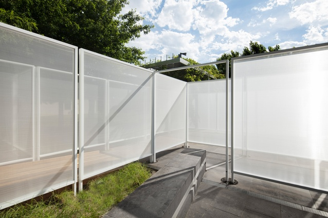 The cladding of <i>Garden Wall</i> by Retallack Thompson and Other Architects is reflective in direct light and translucent when backlit.