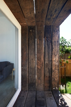 Detail of timber sleepers framing French doors.