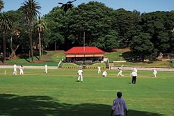 The refurbished pavilion seen across the oval. The original structure had developed a pronounced lean – a condition embraced by the architects.