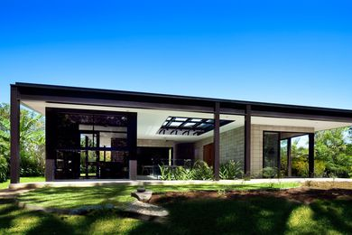 The house references Philip Johnson's International Style Glass House, minus the glass.