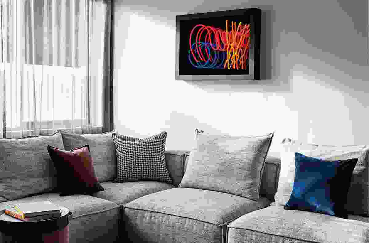 Neon art boxes by Karl Gordon are used in guest rooms.