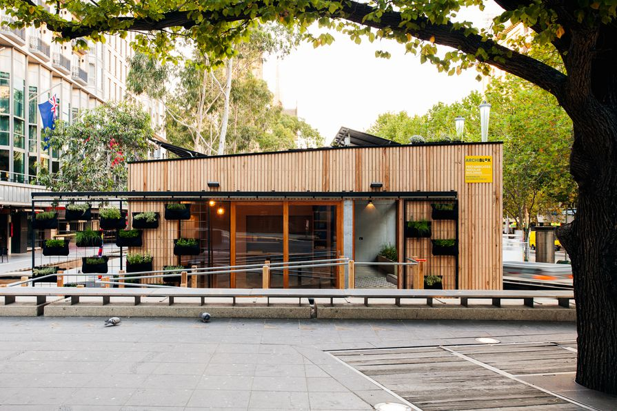 The carbon positive prefabricated house by Archiblox uses a retractable green wall to help shade the house.