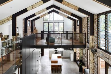 The double-height living space conforms to the gable-roofed extrusion of the barn typology.
