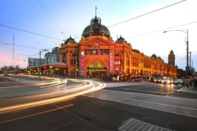 Flinders St Station at dusk.
