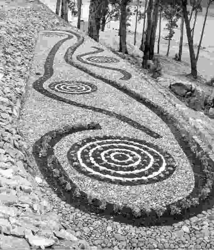 The Parterre Garden at Serpentine Dam, designed by John Oldham circa 1961, was based on the pattern taken from a rubbing of a sacred ritual board.
