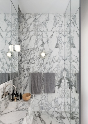 Featuring marble and floor-to-ceiling mirrors, the vanity area is a nod to the luxury of the Art Deco period.