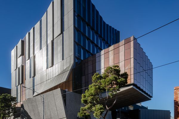 Concrete panels on the facade recede, tilt and fold to provide solar protection yet also reveal sliced silhouettes of life within. A dramatically cantilevered volume accommodates a recital hall.