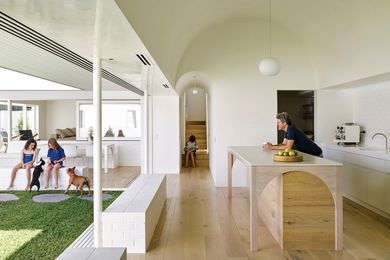 The motif of the barrel vault is carried through the house, with a dramatic, geometric ceiling highlighting the importance of the kitchen.