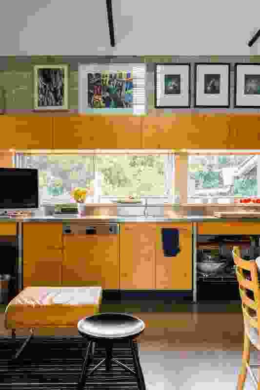 Hoop pine kitchen joinery complements the exposed concrete blockwork walls. Artwork: Bernard Ollis.