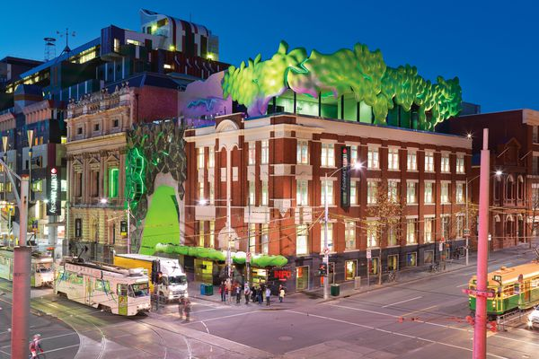 The corner of Swanston and La Trobe Streets in Melbourne, showing RMIT Green Brain (2010) and adjacent RMIT Storey Hall (1995).
