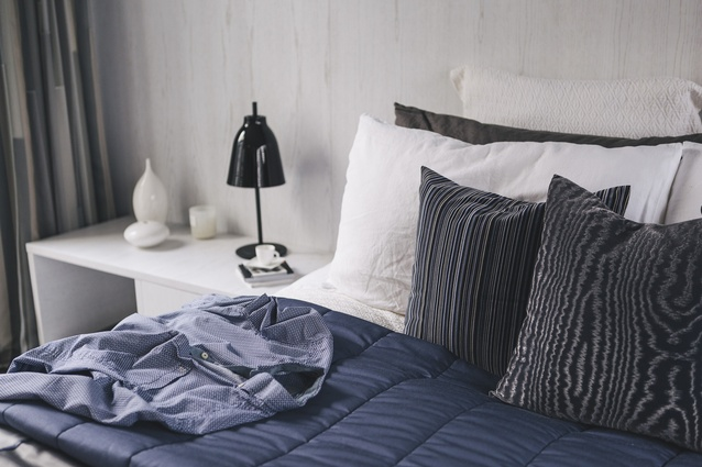 A purple bedspread in the bedroom is chosen to complement the homeowner's wardrobe.